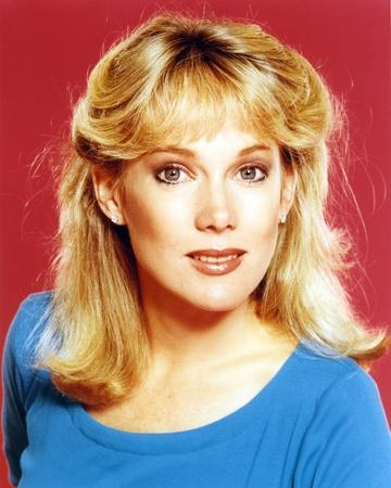 Julia Duffy wearing a Blue Tunic and Earrings in a Close Up Portrait