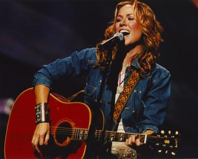 Sheryl Crow singing in Blue Denim Jacket
