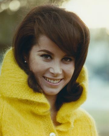 Stefanie Powers smiling in a Portrait wearing Yellow Winter Coat