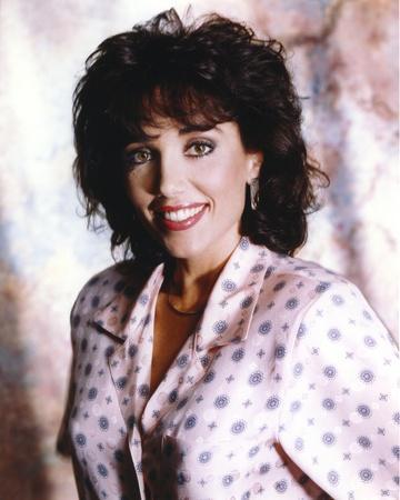 Stepfanie Kramer smiling in a Portrait wearing Blouse
