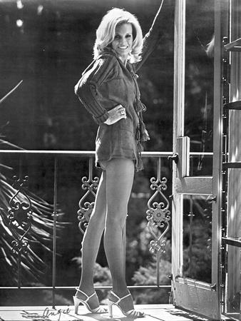 Angie Dickinson standing Near the Railings wearing Long Sleeves and Shoes in Black and White