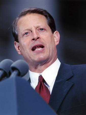 Al Gore Delivering a Speech wearing a Black Suit and A Red Tie