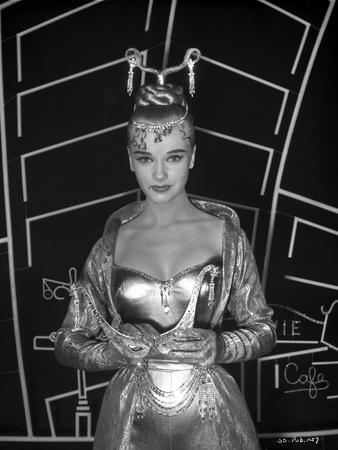 Anne Francis in Elegant Gown Holding a Mask