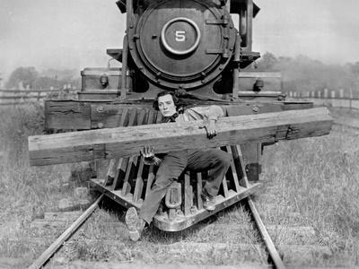 Buster Keaton Carrying a Huge Wood on a Train