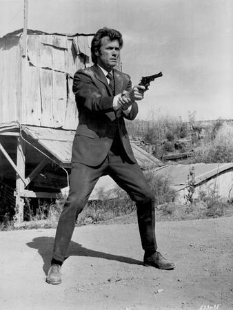 Clint Eastwood standing in Black Suit with Pistol