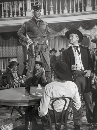 Calamity Jane standing on The Table While Talking in Police Uniform