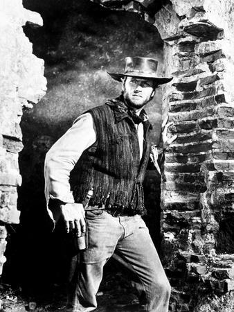 Clint Eastwood standing in Movie Scene, wearing Cowboy Attire