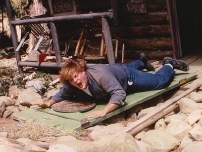 Chris Farley Lying wearing Blue Jacket