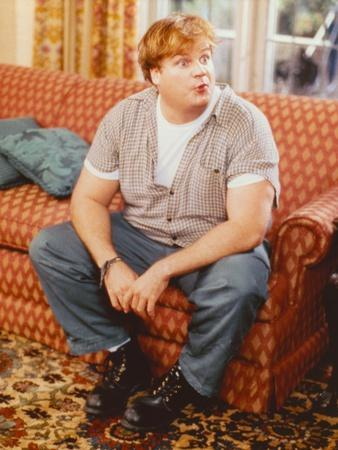Chris Farley sitting on Couch Candid Photo