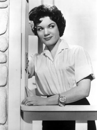 Connie Francis Leaning on Wall, wearing White Dress