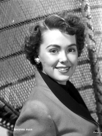 Barbara Rush posed in Coat with Silver Earrings