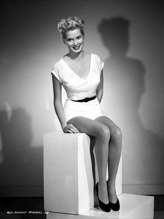 Beverly Michaels Seated wearing White Dress and Black Heels