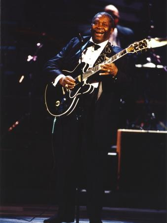 BB King Performing on Stage using Black Les Paul Guitar in Black Suit and Bow Tie
