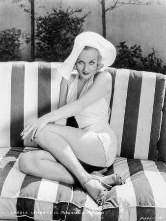 Carole Lombard sitting on a Stripe Couch