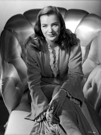 Ella Raines Seated in Classic Robe