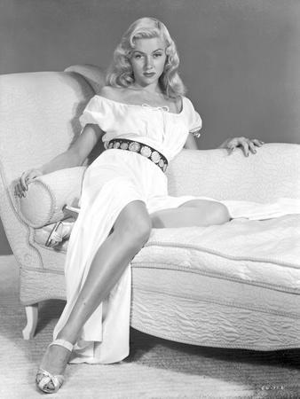 Gloria Grahame Leaning on Couch in White Dress