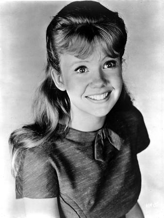 Hayley Mills Looking Up and smiling in a Dress