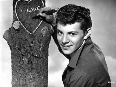 Frankie Avalon Writing on Tree With Pen