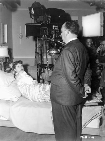 Hitchcock Alfred Filming a Lady on Bed Photograph Print
