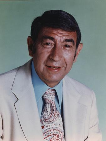 Howard Cosell in White Suit and Printed Necktie