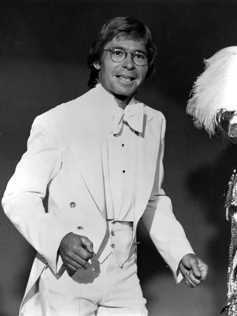John Denver in White Suit With Black Background