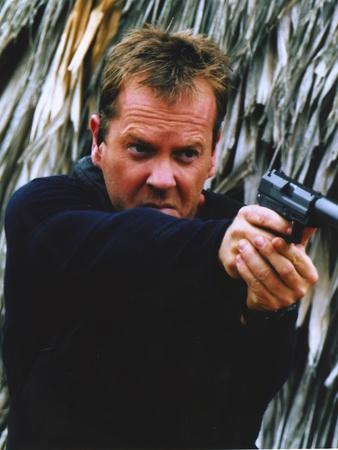 Kiefer Sutherland Pointing a Gun Portrait
