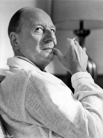 John Gielgud Posed in White Suit With Cigarette