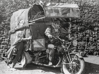La Strada Man Riding in Motor Cart