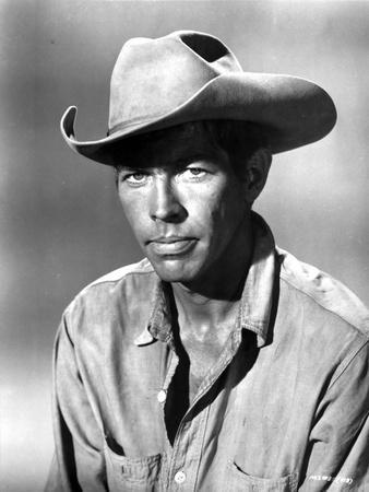 James Coburn in Cowboy Attire With Hat