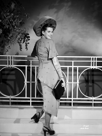 Janis Paige on a Dress standing and smiling