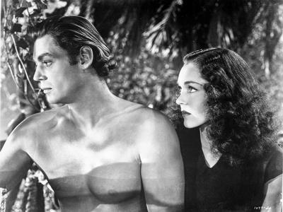 Johnny Weissmuller Being Looked Over by a Woman in a Classic Movie Scene