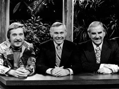 Johnny Carson smiling With Cast