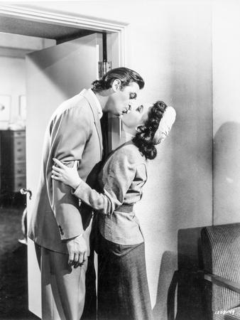 Johnny Weissmuller Kissing a Woman in a Classic Movie Scene