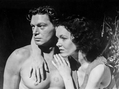 Johnny Weissmuller Hugged by a Woman in a Movie Scene