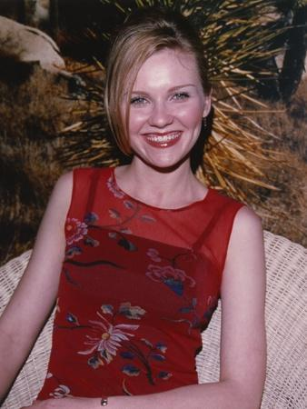 Kirsten Dunst smiling in Red Dress