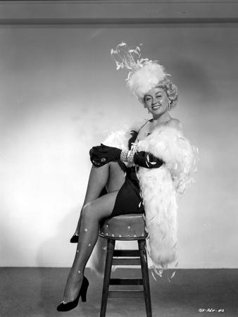 Joan Blondell wearing a Furry Shawl and Hat