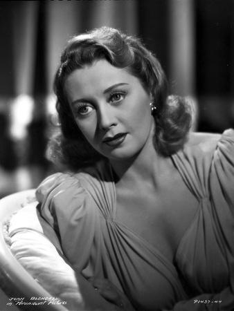 Joan Blondell Lying on the Couch in a Portrait