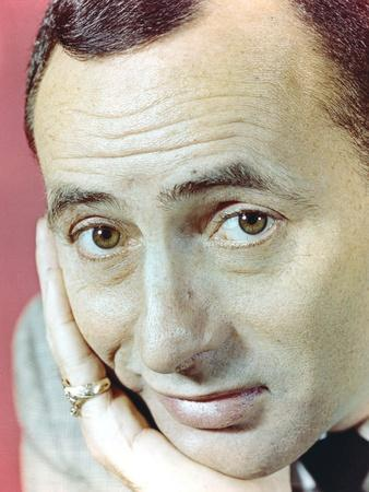 Joey Bishop Showing His Ring in a Close-up Portrait