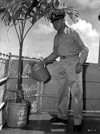 Mister Roberts A Man Holding Water Can