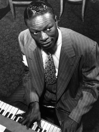 Nat Cole Playing Piano in Black Stripe Suit