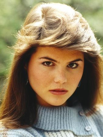 Lori Loughlin wearing a Knitted Blouse and Red lipstick