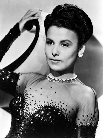 Lena Horne Leaning wearing a Black Gown with Long Gloves