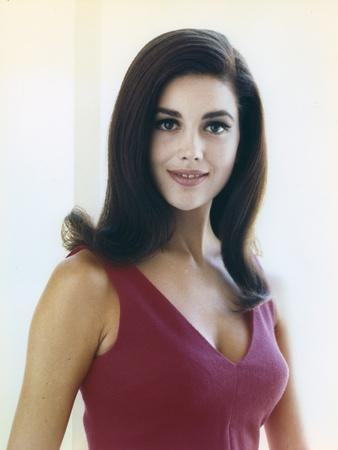Linda Harrison Posed in Red Dress