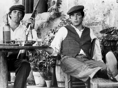 Marlon Brando Seated with a Man Holding a Gun