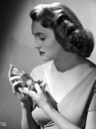 Patricia Neal Holding Perfume in Classic