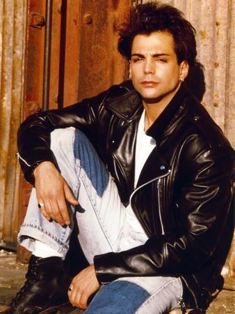 Richard Grieco Seated in Black Leather Jacket