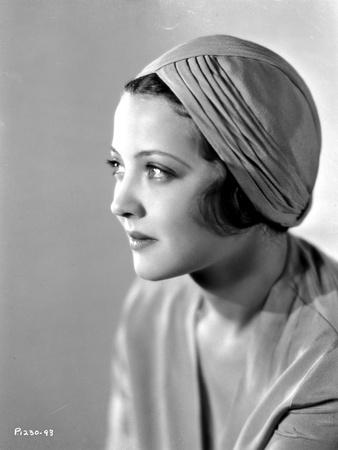 Sylvia Sidney wearing a Dress with Hat