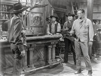 Rio Bravo Pointing Gun to a Man in Cowboy Outfit