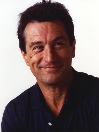 Robert Deniro smiling in Blue Shirt