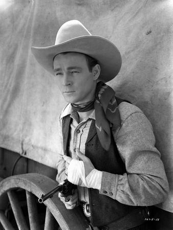 Roy Rogers posed in Cowboy Outfit with Gun in Black and White